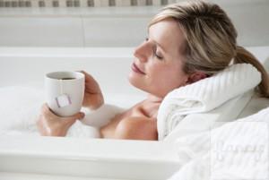 Woman drinking tea in the bath